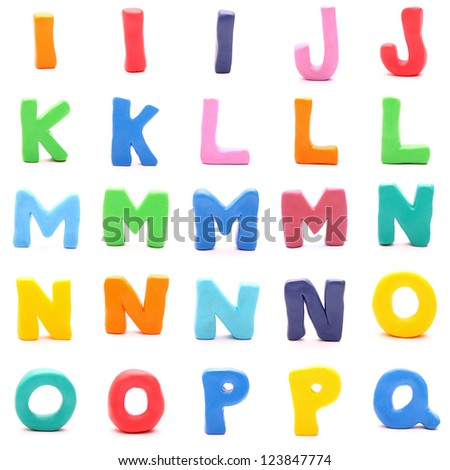"plasticine letters standing on white background (2 of 3 - from ""i"" to ""q"") - stock photo"