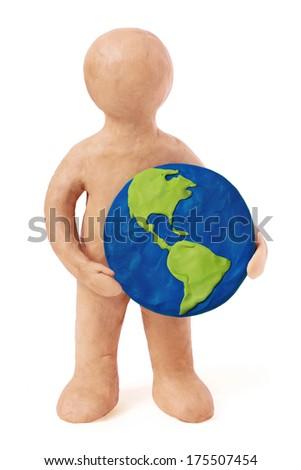 Plasticine man holding earth USA Ameria part on a white background - stock photo
