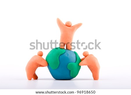 Plasticine of people embracing the earth - stock photo