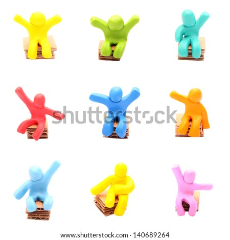 plasticine people set - sitting on paper chairs - stock photo