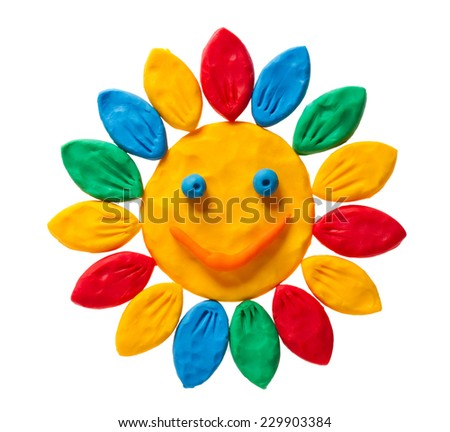 Plasticine smiling flower isolated on white background - stock photo
