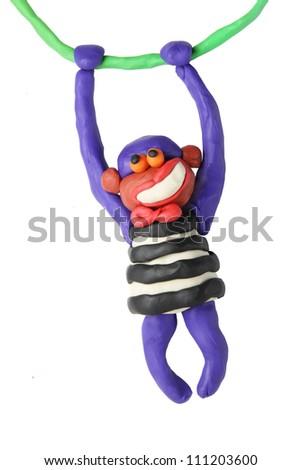 Plasticine smiling monkey on a white background - stock photo