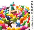 plasticine speaker with bullhorn speaking to a colorful crowd of plasticine people - stock photo