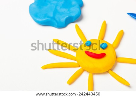 Plasticine sun with emoticons - stock photo