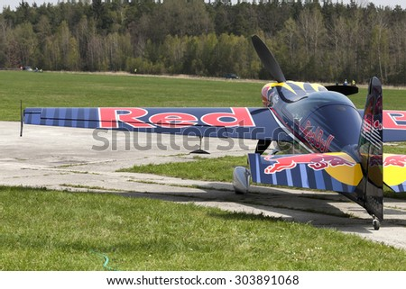 "PLASY, CZECH REPUBLIC - APRIL 27, 2013: Peter Besenyei from Hungary on the Airshow ""The Day on Air"". His aircraft is painted in the colors of Red Bull energy drink for sponsorship reasons"