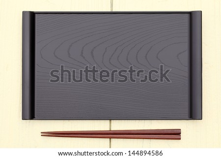 plate and chopsticks with japanese style on wooden table
