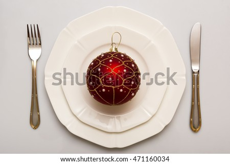 Plate and cutlery. Christmas ball.