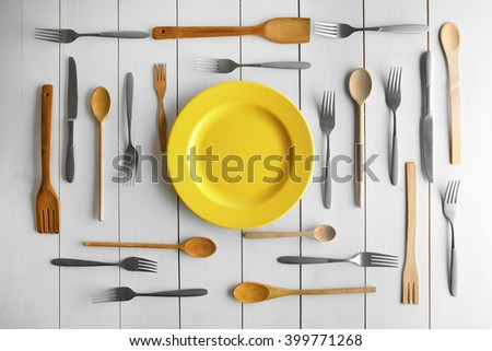 Plate and cutlery on white table, top view - stock photo
