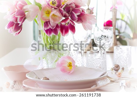 Plate and tulips decoration on white background