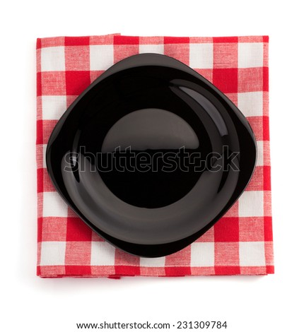 plate at cloth napkin on white background - stock photo