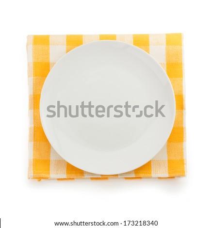 plate at napkin on white background - stock photo