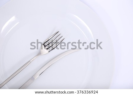 plate, fork  and knife on white background.