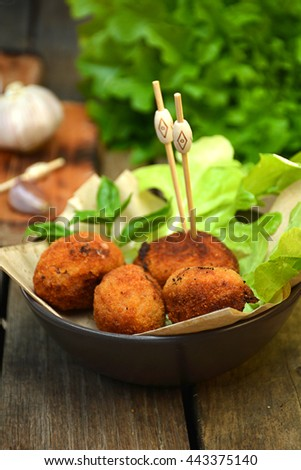 plate full of home-made croquettes of ham, typical Spanish dish - stock photo