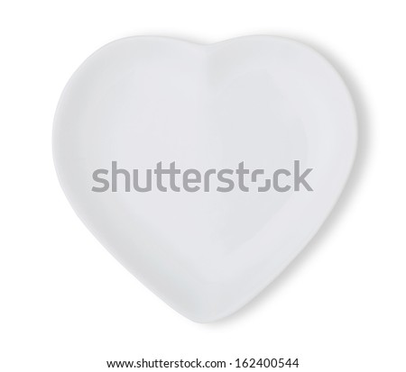 plate in shape of heart - stock photo