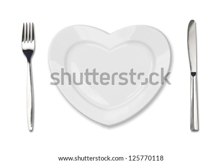 plate in shape of heart, table knife and fork isolated on white - stock photo