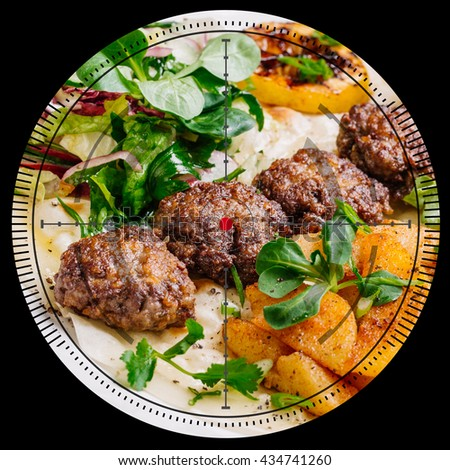 Plate of arabic kebab meat with grilled vegetables and wine on wooden table - stock photo
