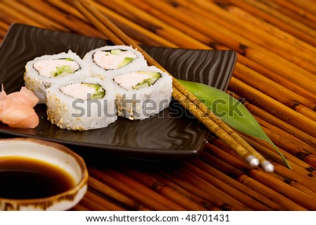 Plate of California rolls with ginger - stock photo