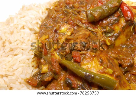 Plate of chicken curry with brown rice