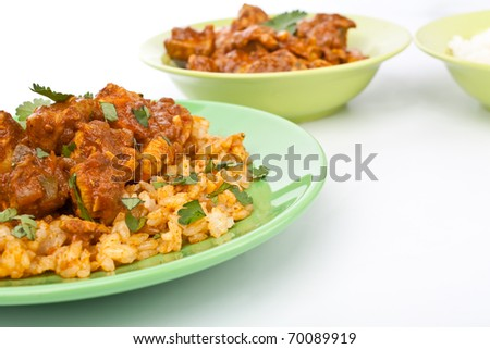 plate of chicken madras curry garnished  with rice close-up - stock photo