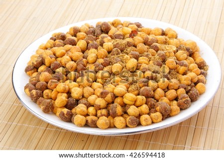 Plate of Chickpeas baked with spices .Selective focus photograph. - stock photo