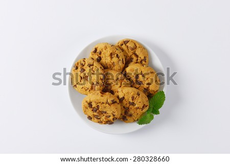 plate of chocolate chip cookies on white background - stock photo