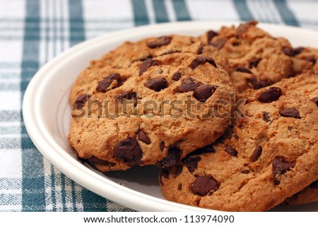 plate of chocolate cookies on green table cloth - stock photo