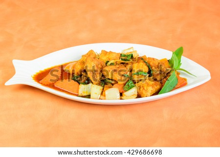 Plate of Cod or Pollack Fish Fillet Stewed in Tomato and Thai Sauce