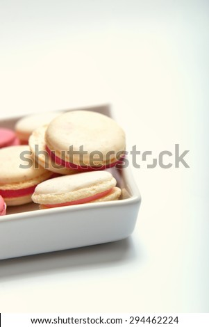 plate of colorful French macaroons in different flavors (shifted the white balance) - stock photo