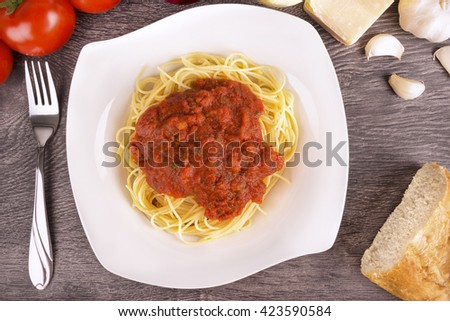 Plate of cooked spaghetti pasta. Top view. - stock photo