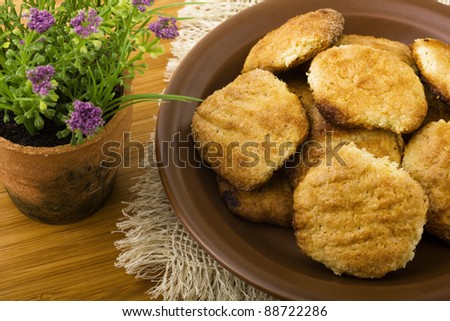 Plate of cookies and flower on wood table