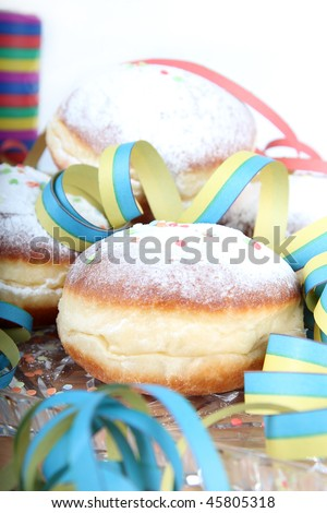 Plate of doughnuts with sugar icing