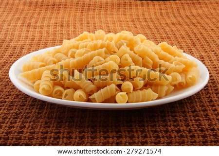 Plate of dry pasta  - stock photo