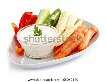 Plate of fresh vegetables and garlic dip - stock photo