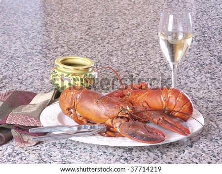 Plate of freshly cooked crab with a glass of wine - stock photo