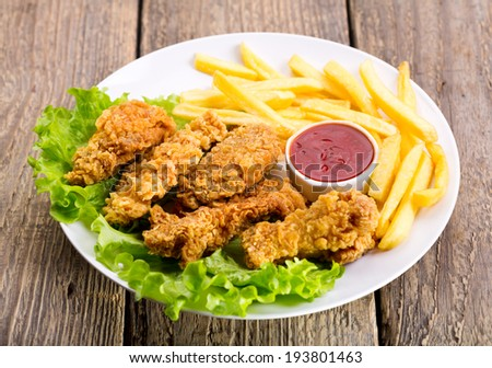 plate of fried chicken with vegetable