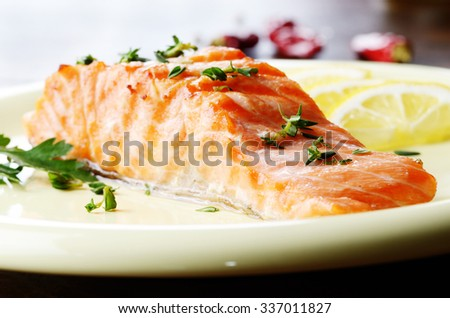 Plate of Fried Salmon with lemon and spices