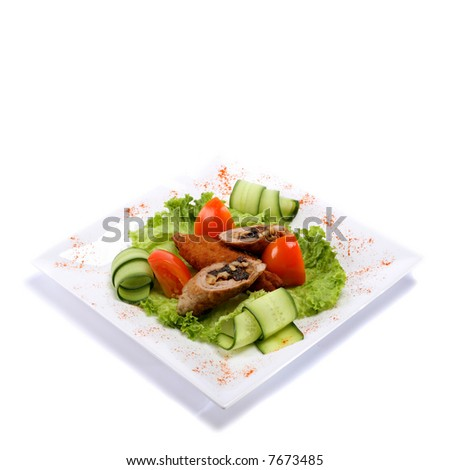 plate of gourmet meat rolls in rectangular plate - stock photo