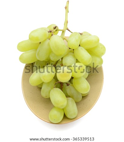 plate of grapes isolated on white