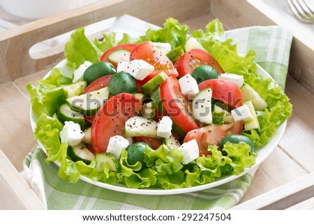 plate of green salad with vegetables, top view, horizontal