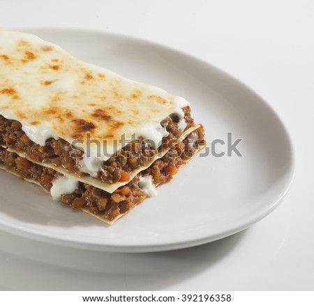 plate of lasagna, typical italian pasta with meat sauce  - stock photo