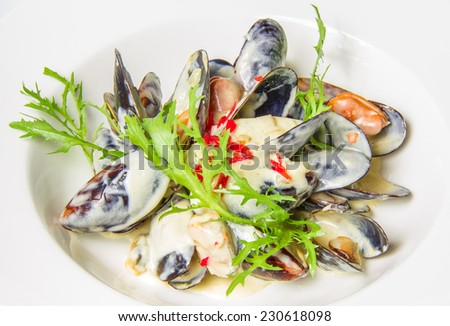 Plate of mussels in sauce with fresh herbs Isolated on white background. Restaurant shot.  - stock photo