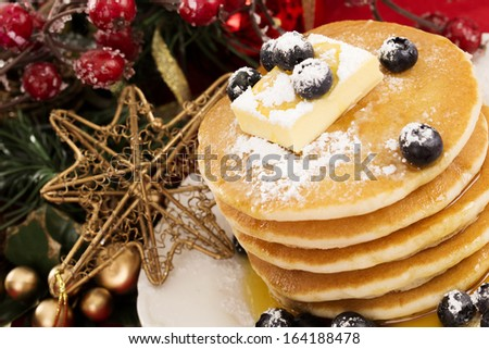 Plate of pancakes with fresh blueberries for Christmas  - stock photo