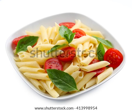 Plate of pasta with cherry tomatoes and basil leaves isolated on white - stock photo