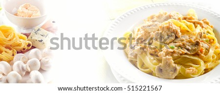 Plate of pasta with mushrooms and cream sauce. Selective focus