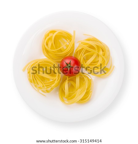Plate of pasta with tomato from above isolated on white. - stock photo