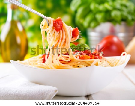 plate of pasta with tomato sauce - stock photo
