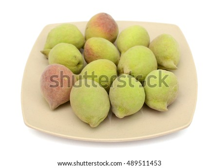 Plate of peach isolated on white