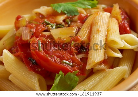 plate of penne rigata pasta with marinara sauce .farm-style