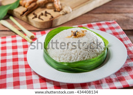Plate of plain rice on the table in restaurant - stock photo