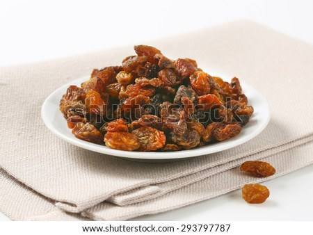 plate of raisins on beige place mat